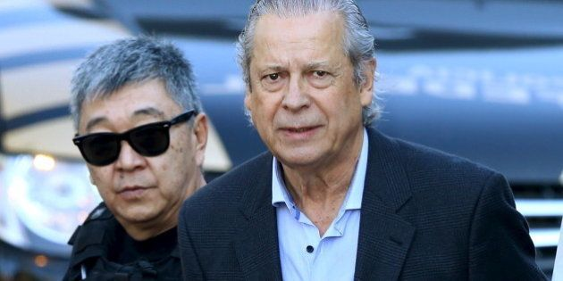 Jose Dirceu (R), former Brazilian President Luiz Inacio Lula da Silva's chief of staff, is escorted by...