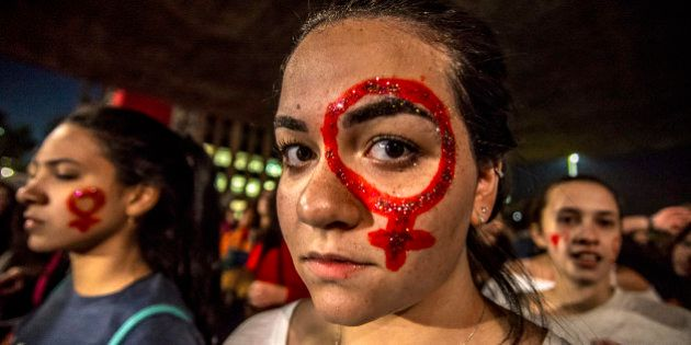 SAO PAULO, BRAZIL - JUNE 08: A woman looks on during a protest against the gang rape of a 16-year-old...