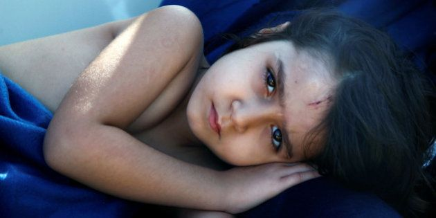 Syrian refugee girl Housaida rests inside the Spanish rescue vessel Astral after being rescued by the...
