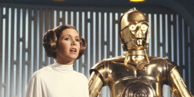 LOS ANGELES - AUGUST 23: Carrie Fisher (as Princess Leia Organa) and Anthony Daniels (as C3PO) star in...