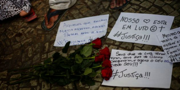 View of signs on the floor during a protest against homophobia at Dom Pedro II station in Sao Paulo,...