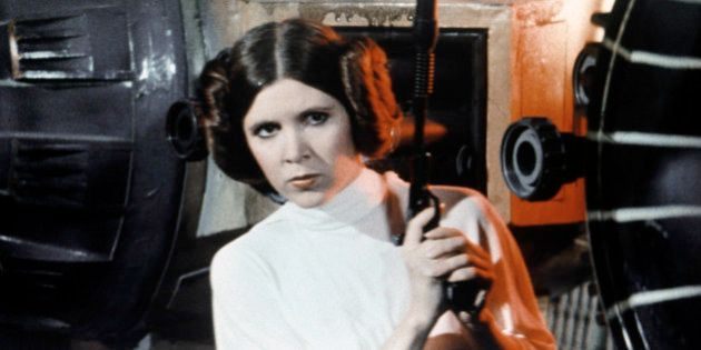 American actress Carrie Fisher on the set of Star Wars: Episode IV - A New Hope written, directed and...