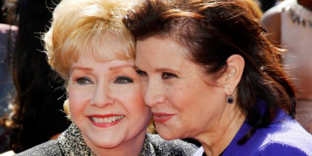 Actress Debbie Reynolds (L) and her daughter Carrie Fisher (R) arrive at the 2011 Primetime Creative...