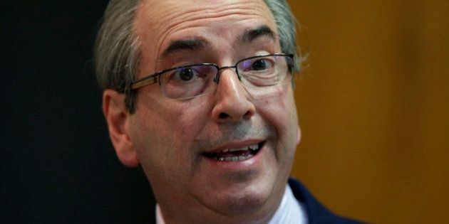 President of Brazil's Chamber of Deputies Eduardo Cunha speaks during a breakfast with journalists at...