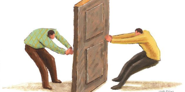 two men pulling a door knob from opposite sides of the same