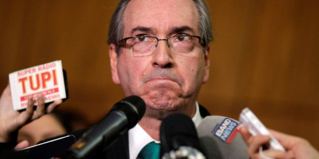 Brazilian suspended House Speaker Eduardo Cunha reacts during a news conference at the National Congress...