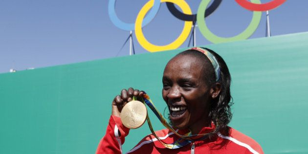 TOPSHOT - Gold medalist Kenya's Jemima Jelagat Sumgong poses after the podium ceremony for the Women's...