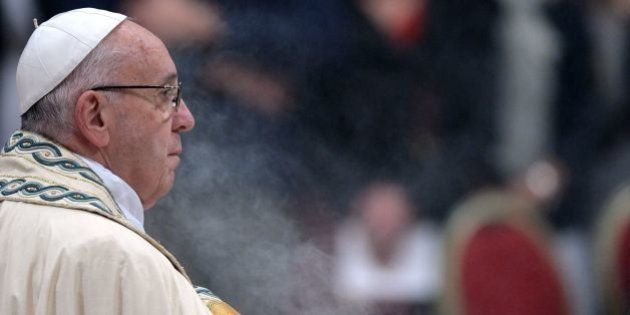 Pope Francis looks on as he presides the Te Deum prayer in St Peter's Basilica at the Vatican, on December...