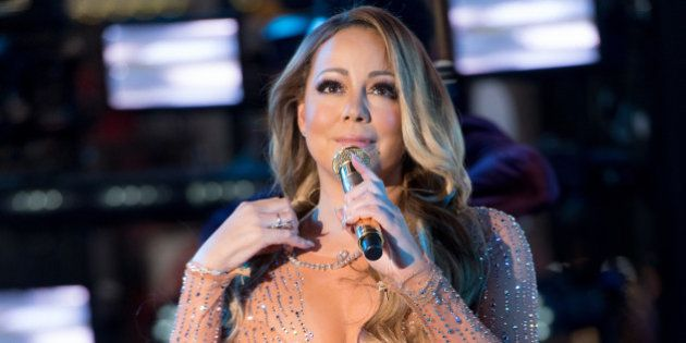 NEW YORK, NY - DECEMBER 31: Singer Mariah Carey performs during New Year's Eve 2017 in Times Square on...