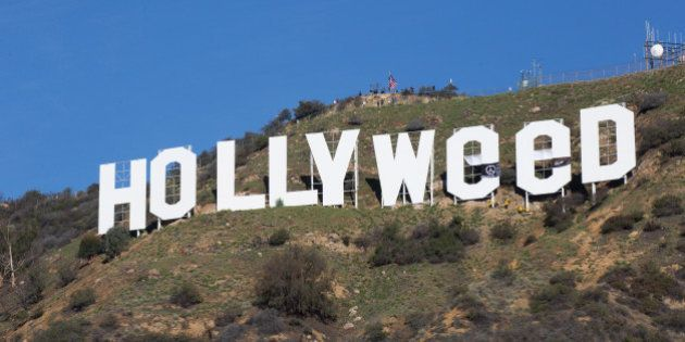 HOLLYWOOD, CA - JANUARY 01: The Iconic Hollywood Sign Gets Changed To Read 'Hollyweed' on January 1,...
