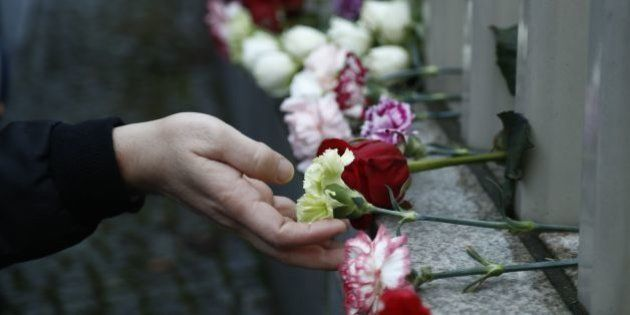 Members of several Islamic religious communities and associations lay down flowers in front of the Turkish...