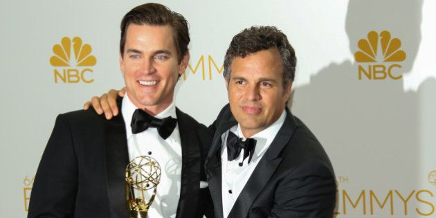 LOS ANGELES, CA - AUGUST 25: Actors Matt Bomer (L) and Mark Ruffalo (R) pose for photos in the press...