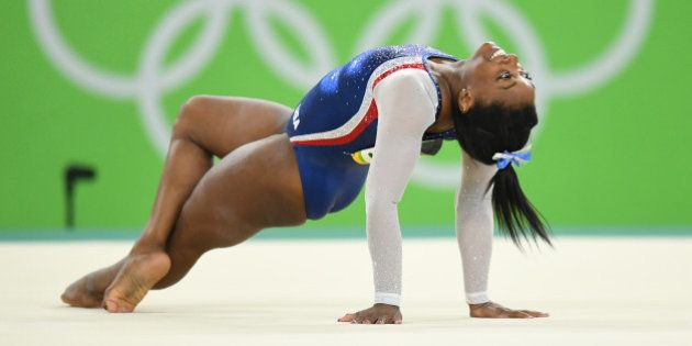 U.S. gymnast Simone Biles finishes her floor routine in the women's All-Around Individual at the Summer...