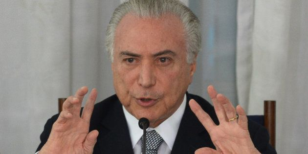 Brazilian President Michel Temer speaks during a breakfast with the media at Alvorada Palace in Brasilia,...