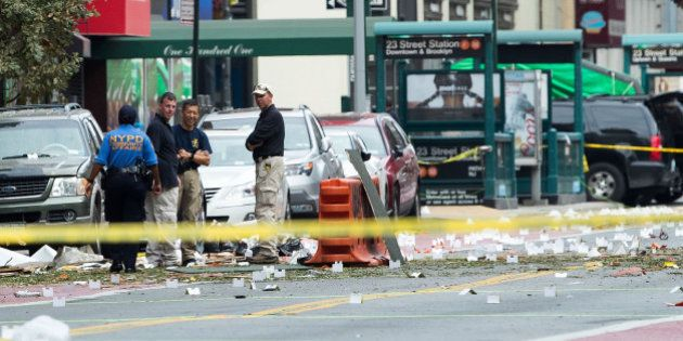 NEW YORK, NY - SEPTEMBER 18: Law enforcement officials work at the scene of Saturday night's explosion...
