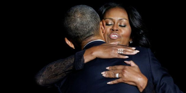 U.S. President Barack Obama embraces his wife Michelle Obama after his farewell address in Chicago, Illinois,...