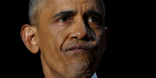 U.S. President Barack Obama staves off tears as he delivers his farewell address in Chicago, Illinois,...