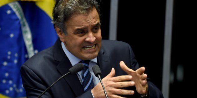Brazilian senator Aecio Neves, from PSDB, delivers a speech during the debate in the Senate of a vote...