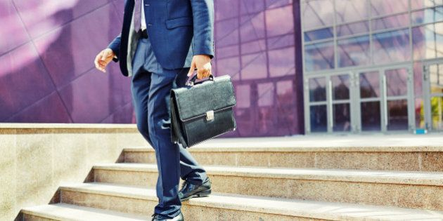 Image of businessman leaving office