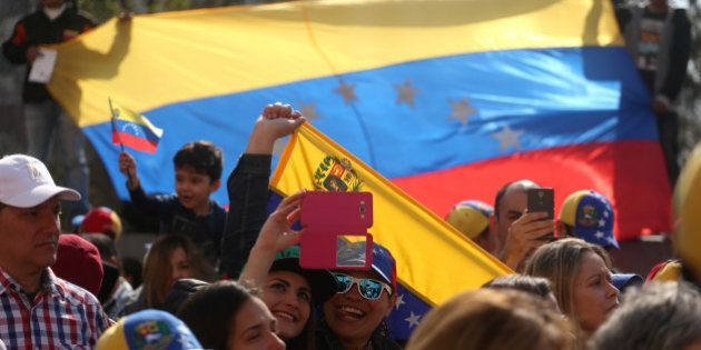 Venezuelans living in Chile protest the government of Venezuela's President Nicolas Maduro in Santiago,...
