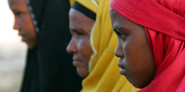 Returned refugee women look on at the State House camp December 3, 2004 in Hargeisa, the capital of Somaliland,...