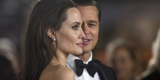 Director and cast member Angelina Jolie and her husband and co-star Brad Pitt pose at the premiere