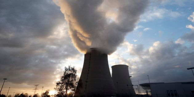 Steam rises at sunset from the cooling towers of the Electricite de France (EDF) nuclear power station...