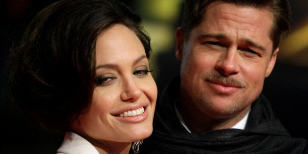 U.S. actors Brad Pitt and his partner Angelina Jolie pose for photographers on the red carpet at the German premiere of the movie