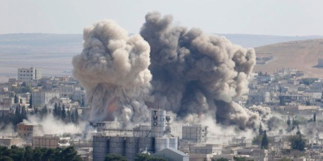 Smoke rises after an U.S.-led air strike in the Syrian town of Kobani Ocotber 8, 2014. U.S.-led air strikes...