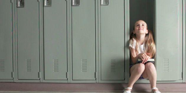 Girl sitting in locker