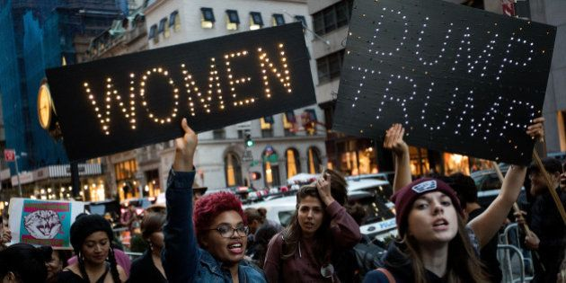 NEW YORK, NY - NOVEMBER 3: A group of protestors, comprised mostly of women, rally against Republican presidential candidate Donald Trump outside of Trump Tower, November 3, 2016 in New York City. Election Day is less than a week away in the United States, where citizens will choose between Donald Trump and Hillary Clinton to become the next president. (Photo by Drew Angerer/Getty Images)