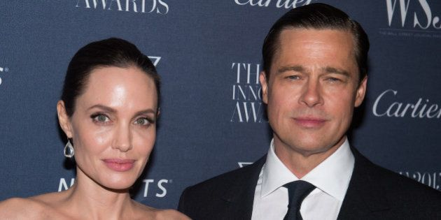 FILE - In this Nov. 4, 2015 file photo Angelina Jolie Pitt and Brad Pitt attend the WSJ Magazine Innovator...