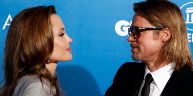 U.S. actress and director Angelina Jolie and her partner actor Brad Pitt arrive for