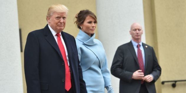 US President-elect Donald Trump and his wife Melania leave St. John's Episcopal Church on January 20,...