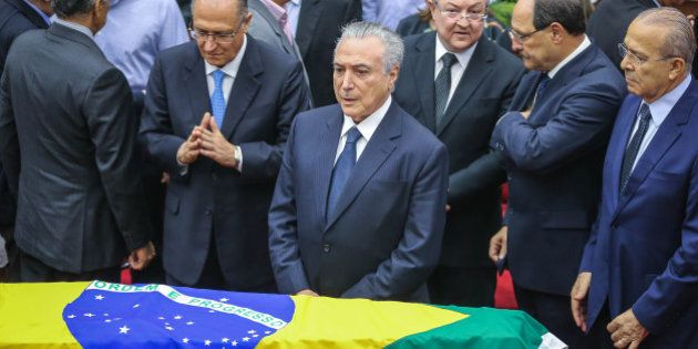 Brazilian President Michel Temer (C) attends the funeral of Supreme Court Justice Teori Zavascki at the...