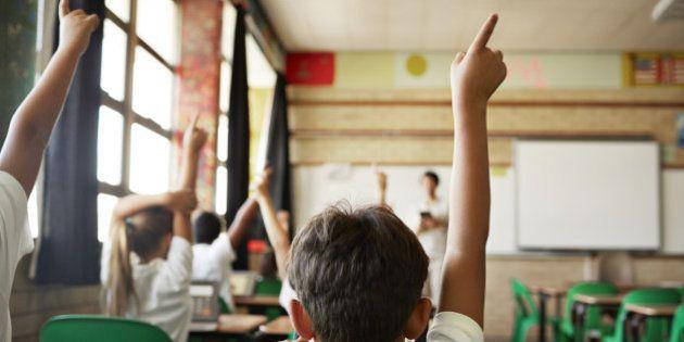 School children in uniforms in class with