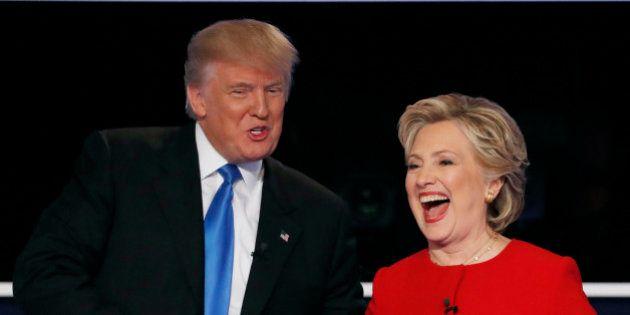 Republican U.S. presidential nominee Donald Trump shakes hands with Democratic U.S. presidential nominee...