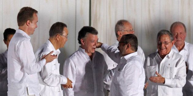 Colombian President Juan Manuel Santos (3rd L) and Marxist FARC rebel leader Rodrigo Londono (2nd R),...