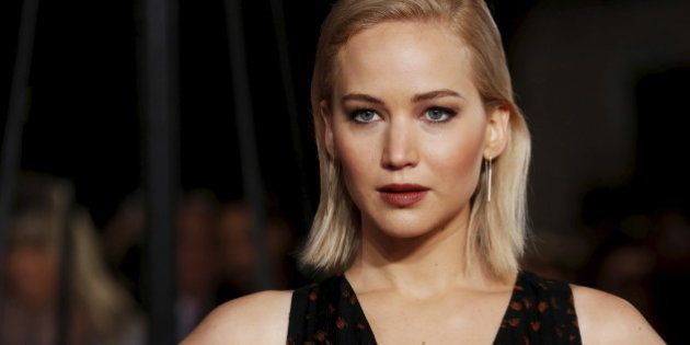 Actress Jennifer Lawrence poses for photographers on the red carpet at the UK premiere
