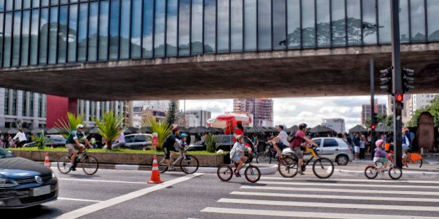 Several cyclists of different age in front of the MASP, Museum of Art of São Paulo, in Paulista Avenue....