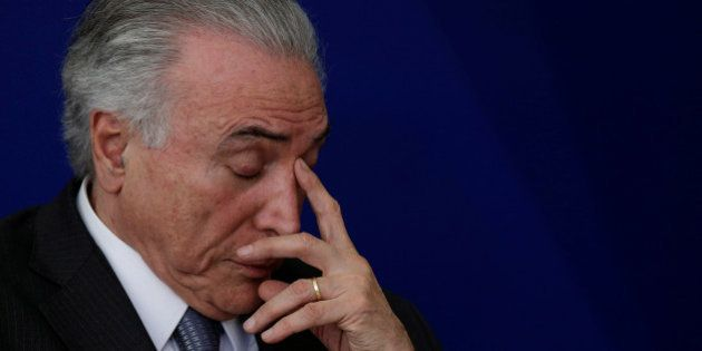 Brazil's President Michel Temer reacts during launch ceremony of