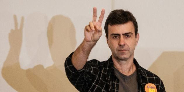 Rio de Janeiro's mayoral candidate, Marcelo Freixo, of the Socialism and Freedom Party (PSOL), gestures...