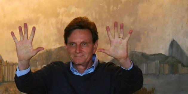 Rio de Janeiro's Mayor candidate, Marcelo Crivella, the Brazilian Republican Party (PRB), gestures after...