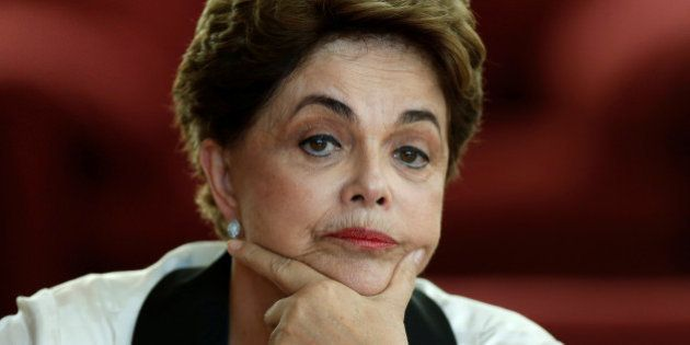Brazil's former President Dilma Rousseff reacts during a news conference for foreign journalists at Alvorada...