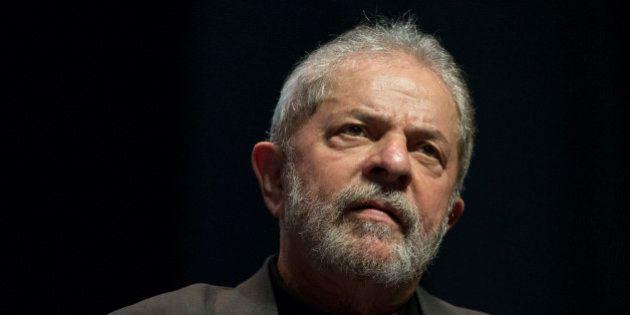 Brazil's Former President Luiz Inacio Lula da Silva speaks at a rally in defense of public companies...