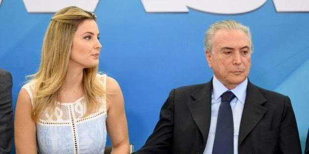 Brazilian President Michel Temer (C) and his wife Marcela are pictured during the launching ceremony...