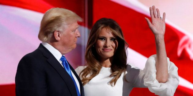 Melania Trump stands with her husband Republican U.S. presidential candidate Donald Trump at the Republican...