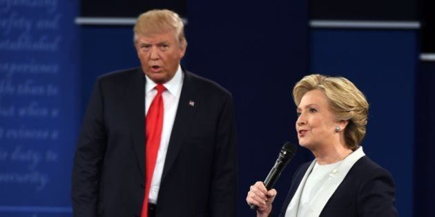 TOPSHOT - US Democratic presidential candidate Hillary Clinton and US Republican presidential candidate...