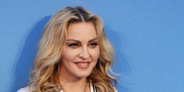 Musician Madonna poses for photographers upon arrival at the World premiere of the film 'The Beatles,...