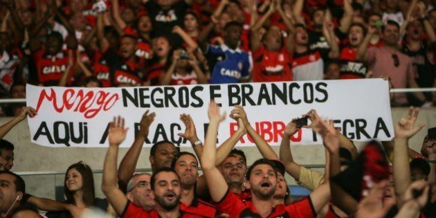 Flamengo's fans hold a placard against racism before their Brazilian championship match against Gremio,...